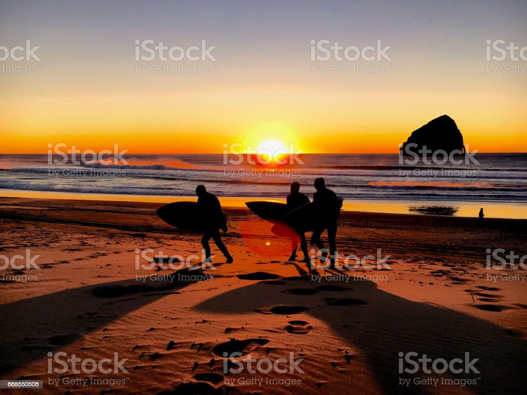 Surfers Ending the Day stock photo