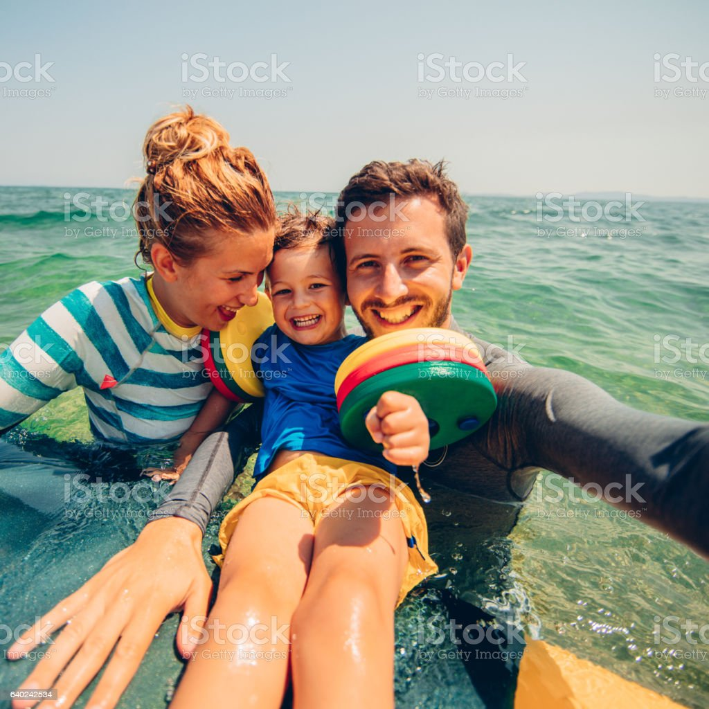 Surfer's family selfie stock photo