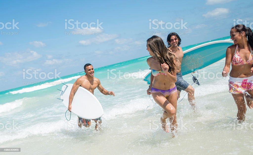 Surfers having fun royalty-free stock photo