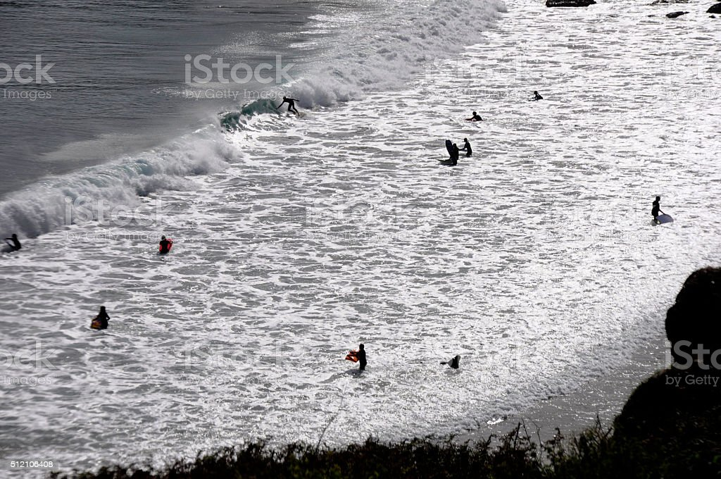 Surfers in Coverack Bay stock photo
