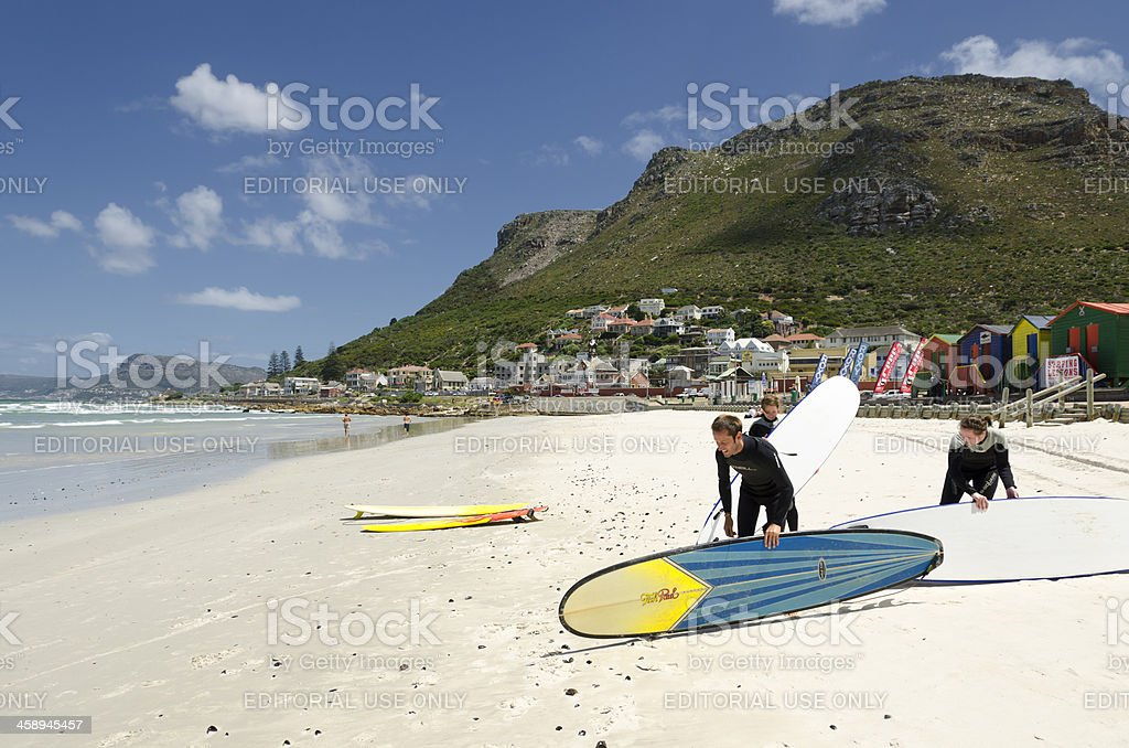 Surfers in Muizenberg stock photo