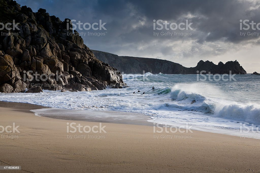 Surfers in Porthcurno. stock photo
