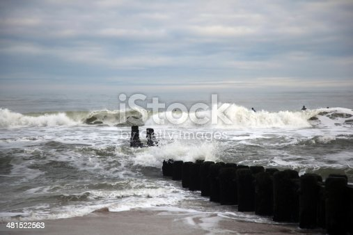 Surfers taking advantage of stormy seas on Long Beach Island on New Jersey's East Coast.  rr