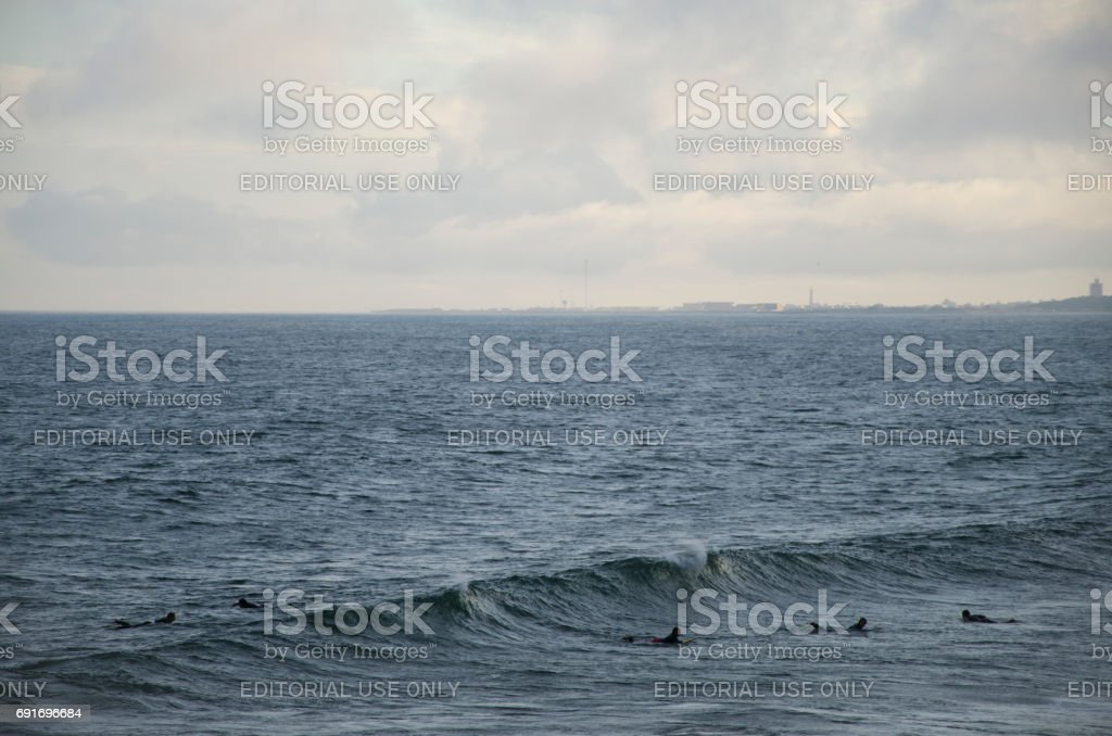 Surfers in the sea stock photo