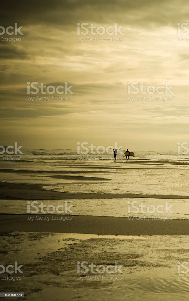 Surfers in Waves, Toned royalty-free stock photo