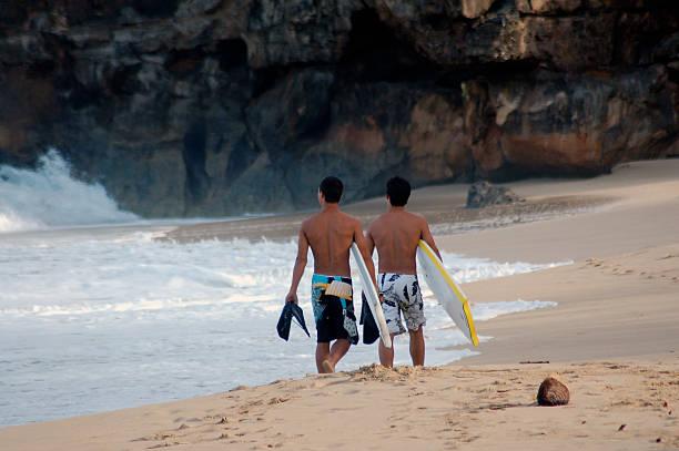 Surfers on Beach stock photo
