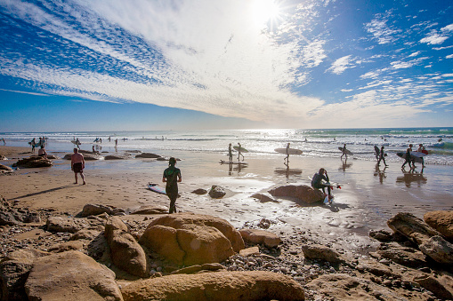 Surfers On Coast Morocco Africa Stock Photo - Download Image Now