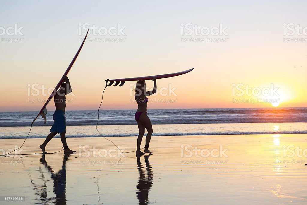 Surfers on the beach royalty-free stock photo