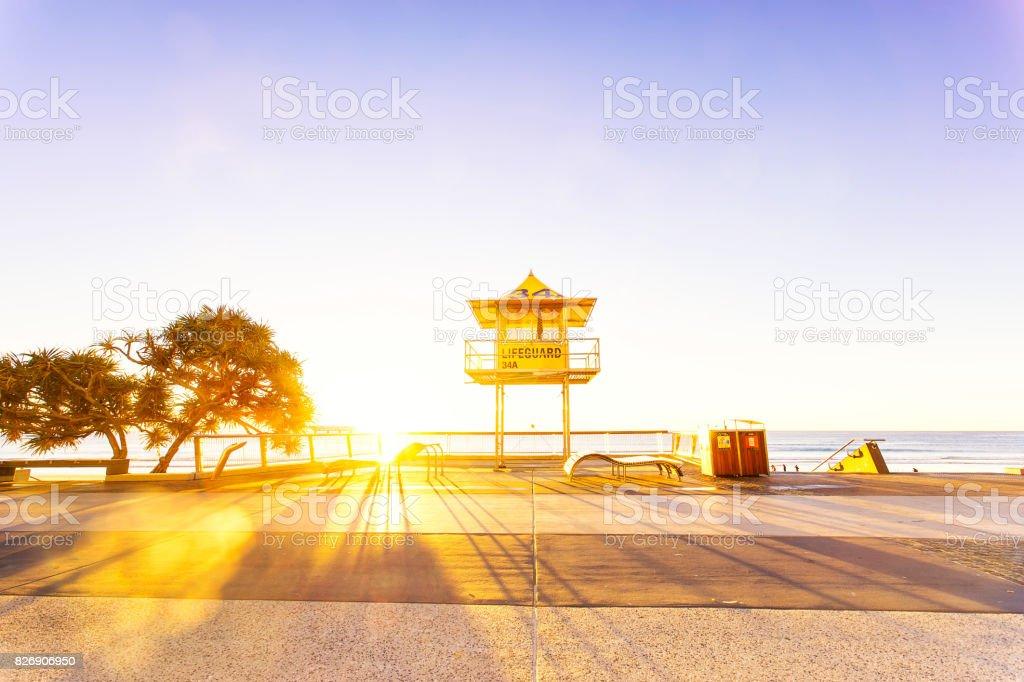 Surfers Paradise lifeguard tower at sunrise stock photo
