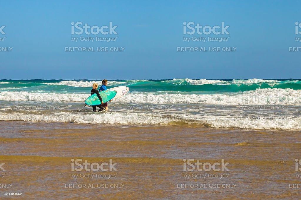 Surfers stock photo