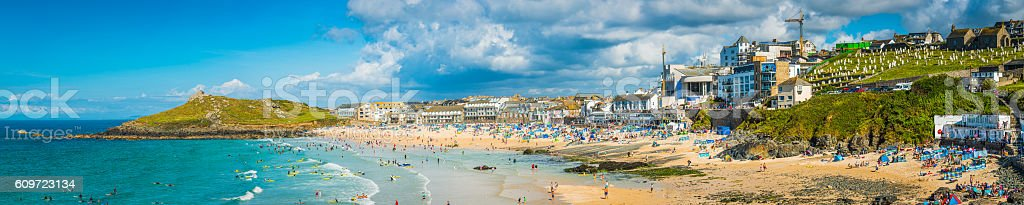 Surfers sunbathers seaside ocean resort beach panorama St Ives Cornwall stock photo