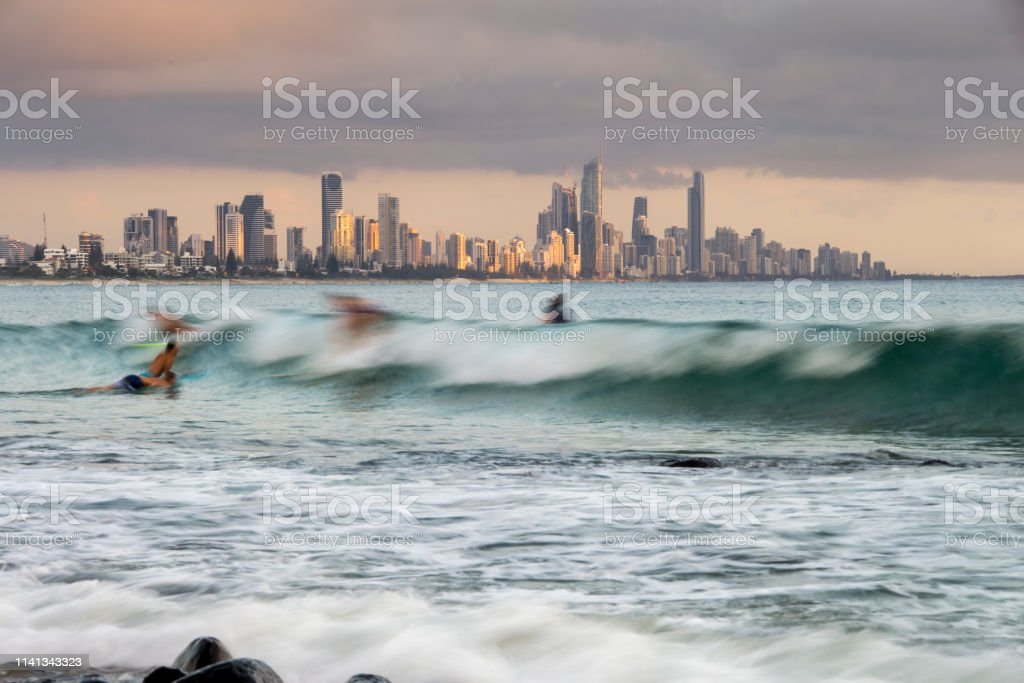 Surfers surfing stock photo