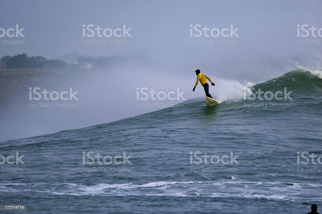 Surfing a BIG wave -2 stock photo