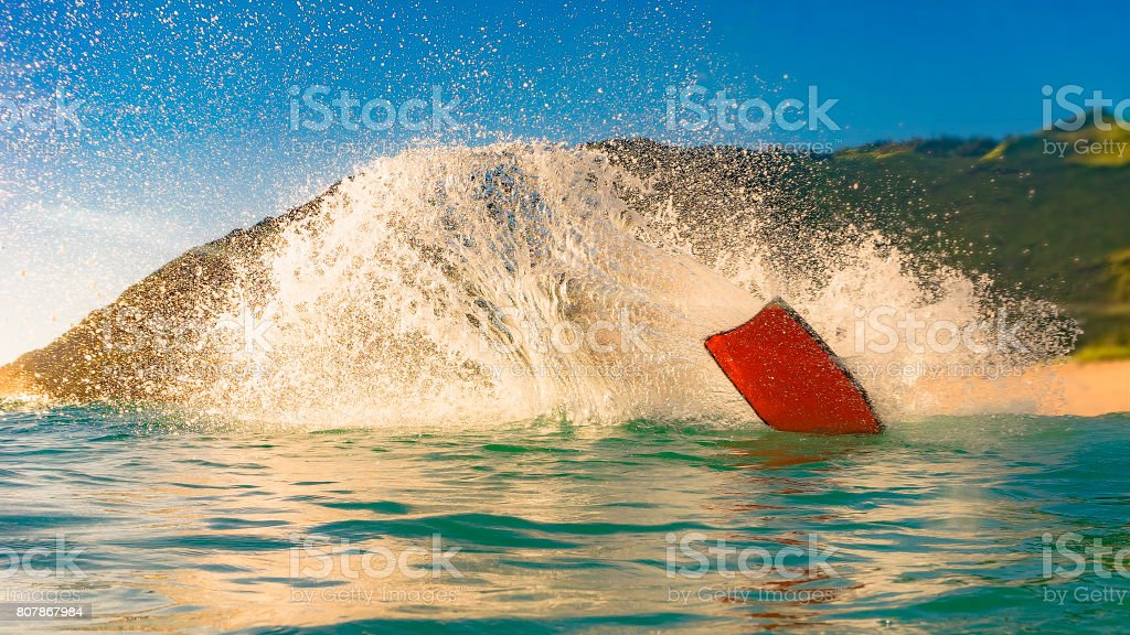 surfing a wave spray stock photo