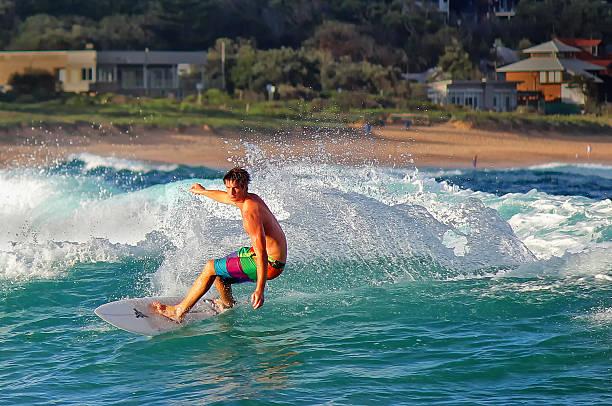 Surfing at Avoca Beach,Australia stock photo