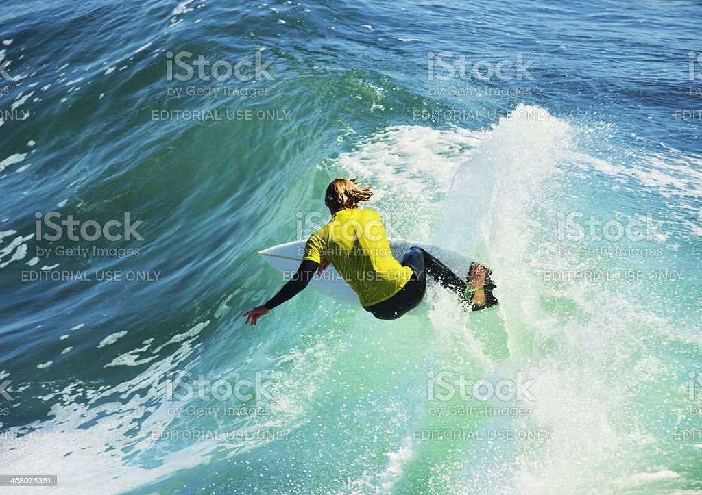 Surfing Athlete Performs Stunts stock photo