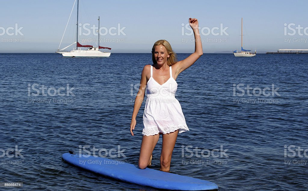 Surfing Beauty At the Beach royalty free stockfoto