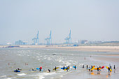 Surfer class in a row walking into the sea at Blankenberge beach, Belgium Europe