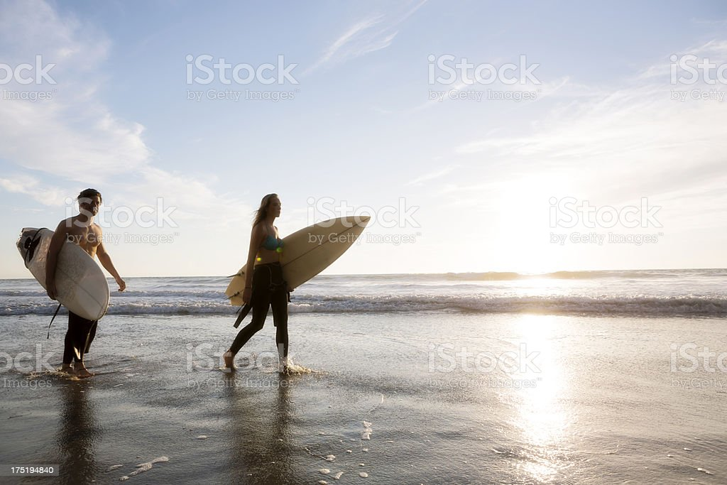 Surfing couple royalty-free stock photo