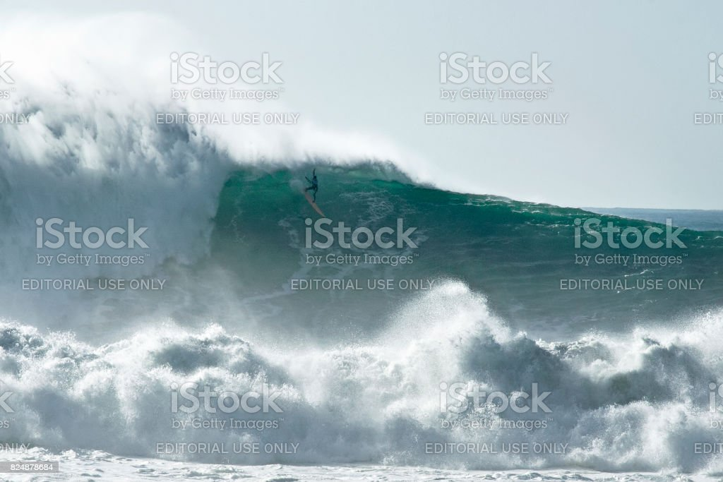 Surfing Dangerous Big Waves stock photo