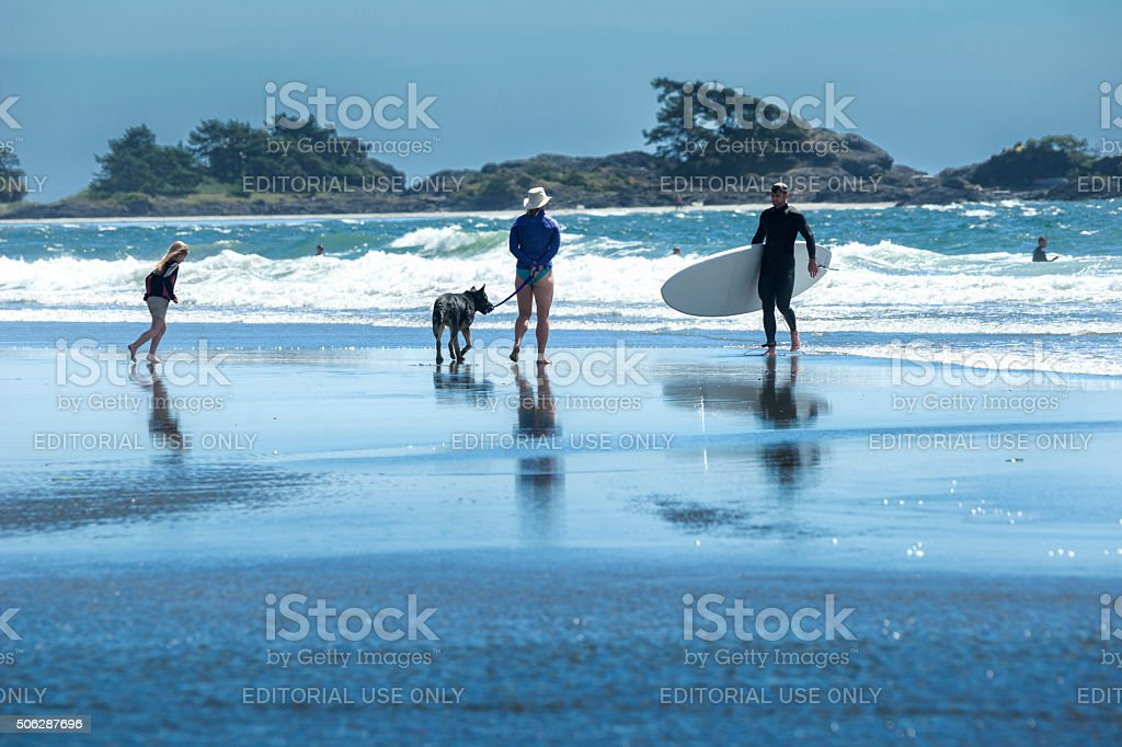 Surfing family on beach in Tofino stock photo