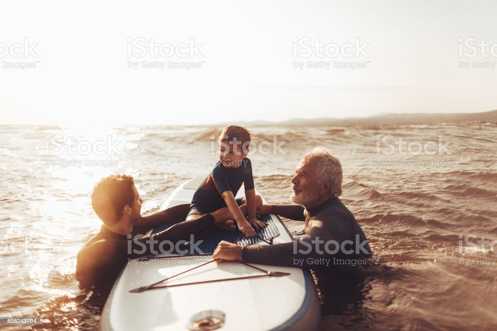 Surfing family stock photo