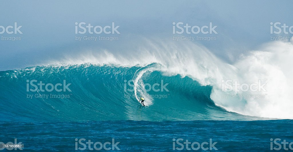 Surfing Giant Waves stock photo