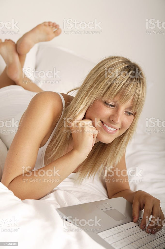 Surfing in bed royalty-free stock photo