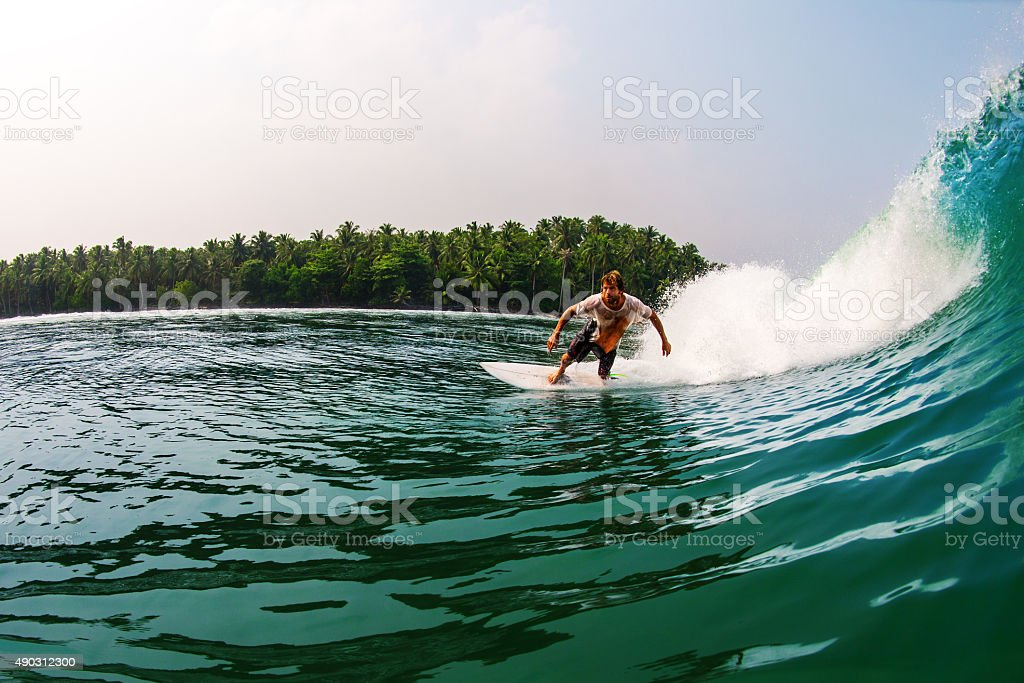 Surfing In Indonesia stock photo