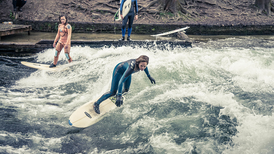 Surfing in Munich at Englischer Garten is dangerous but possible: at one channel crossing the park a big artificial wave is generated on a concrete step