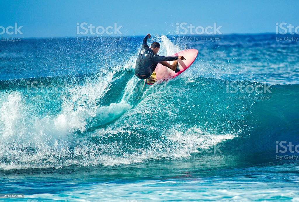 Surfing in the Beach of Kauai Hawaii Horizontal stock photo