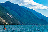 Surfing in the Garda Lake in spring