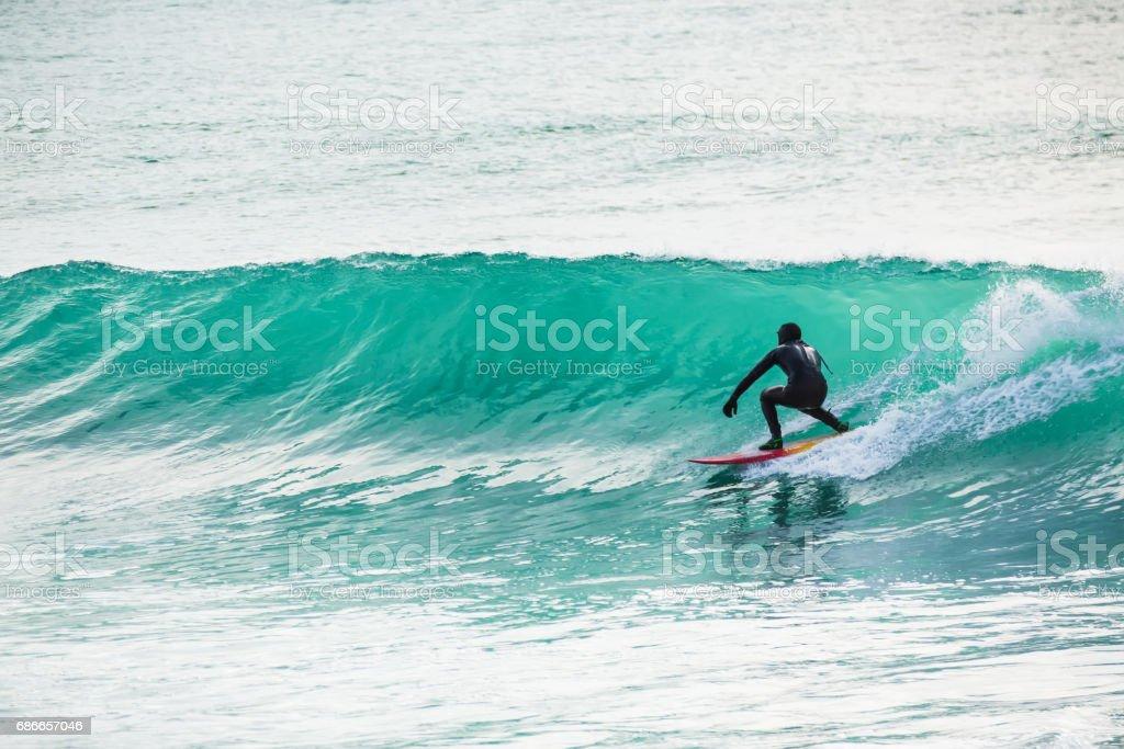 Surfing in turquoise barrel in ocean royalty-free stock photo