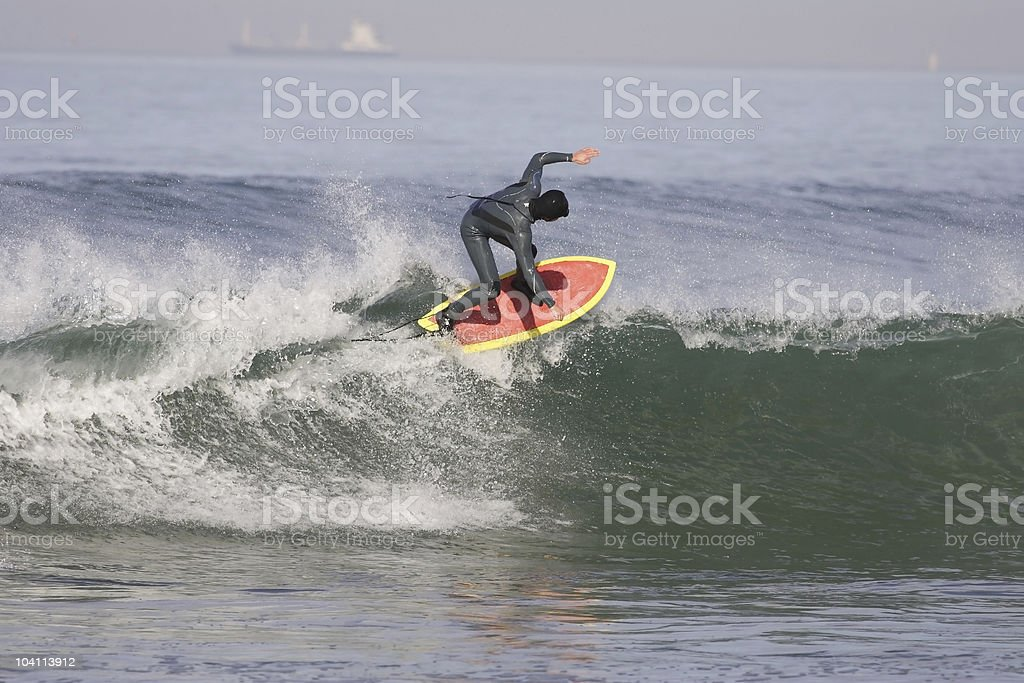 surfing in winter stock photo