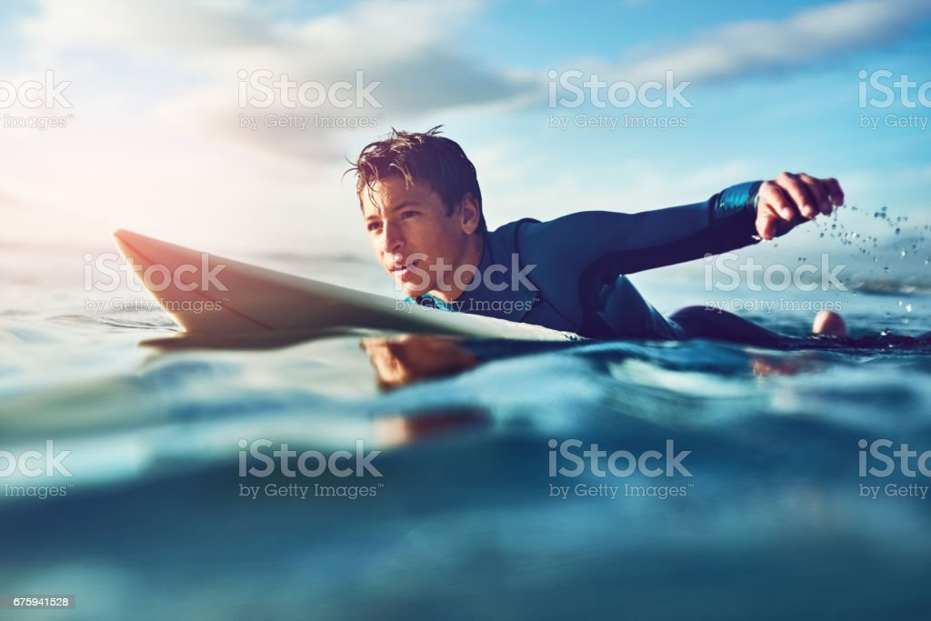 Surfing inspires independence stock photo