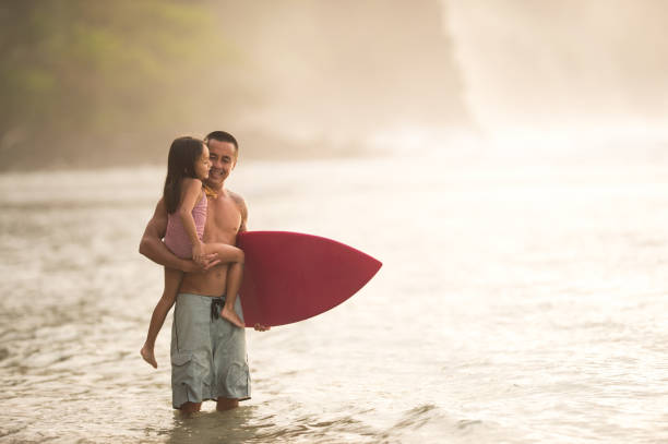 surfing lesson from dad - hawaiian ethnicity stock photos and pictures