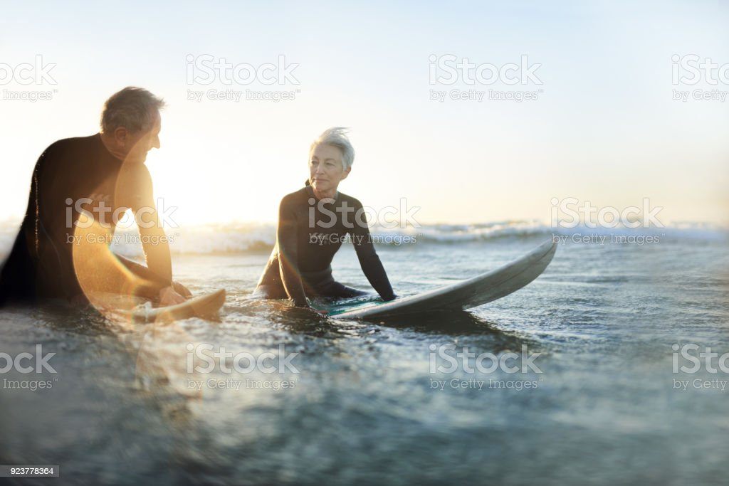 Surfing makes them feel young again stock photo