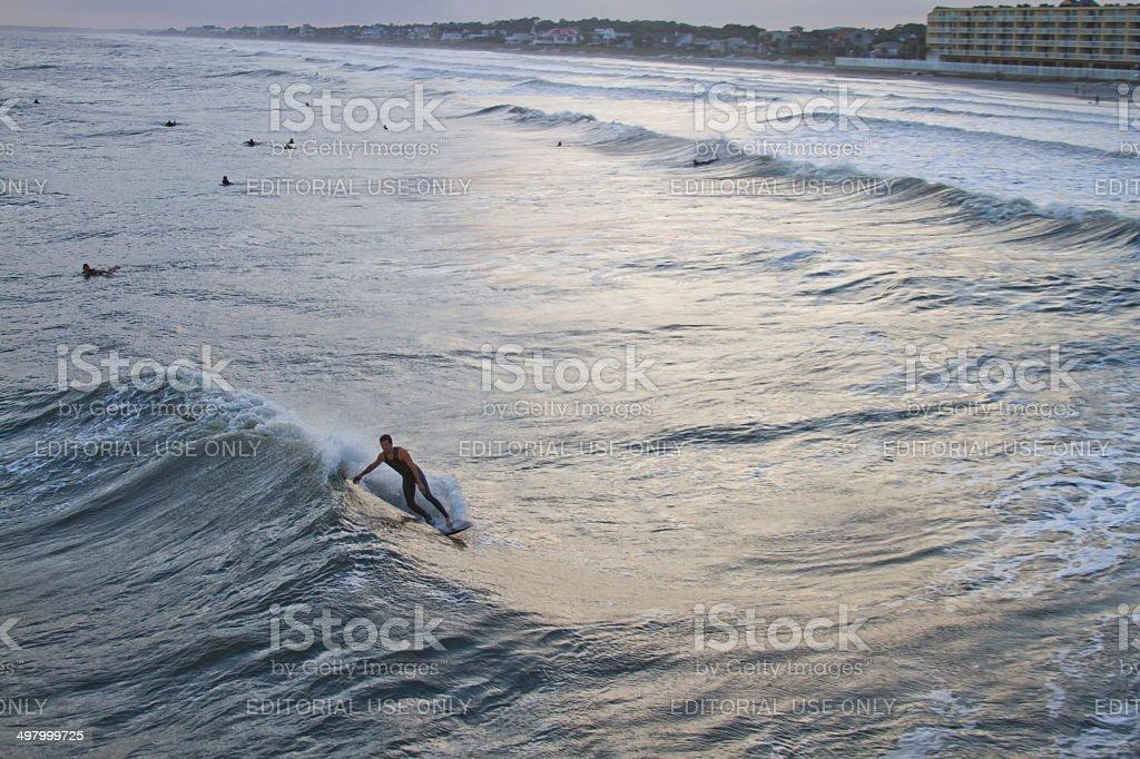 Surfing Off Folly Beach, South Carolina stock photo