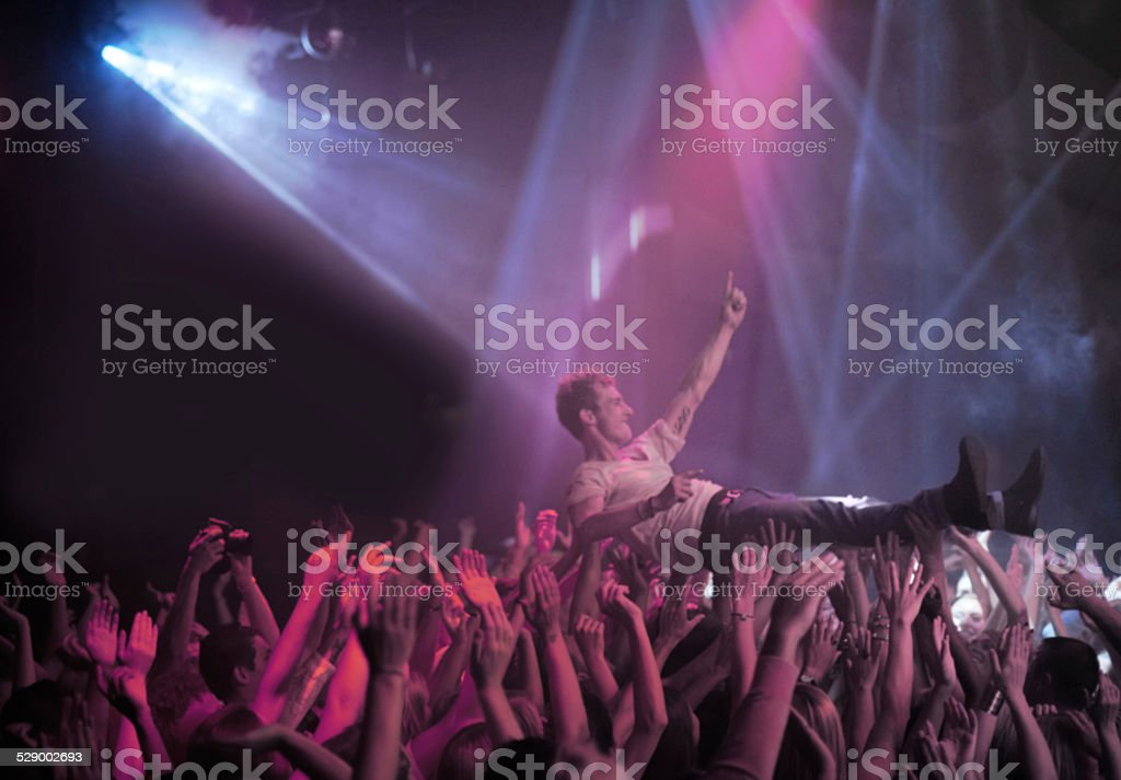Surfing on a wave of praise stock photo