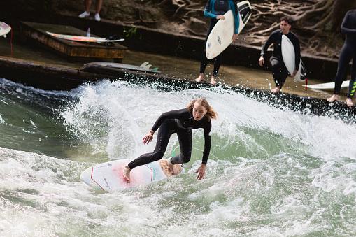 Surfing on Eisbach river in Munich, Bavaria