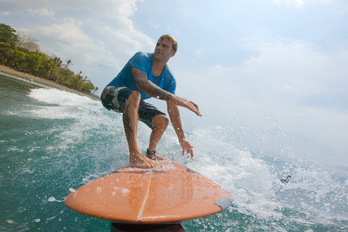 surfing on a wave in Costa Rica