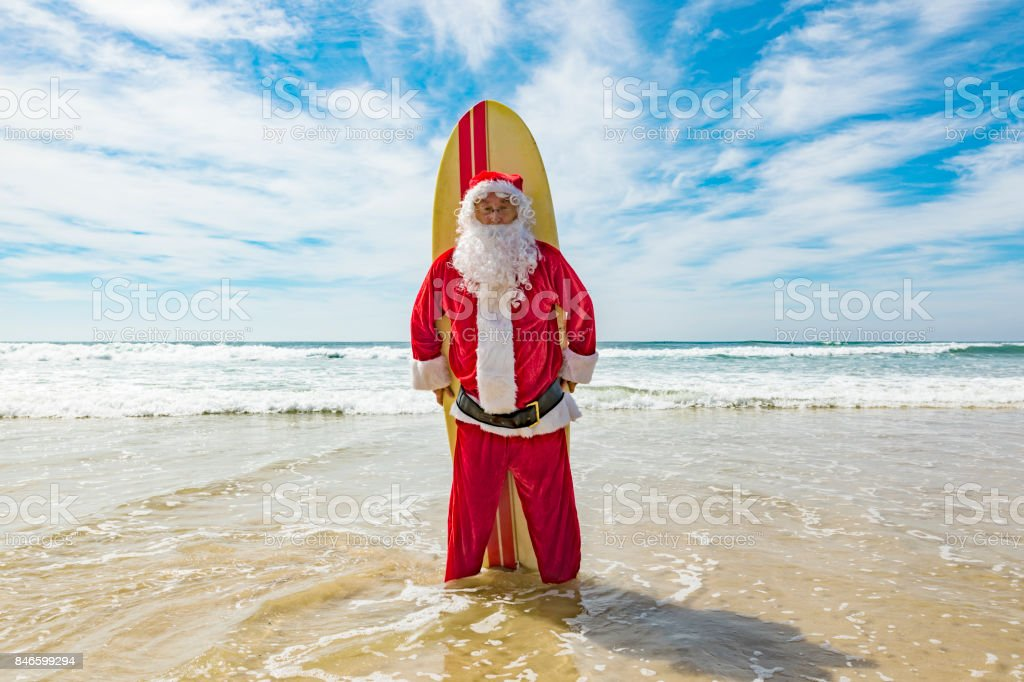 surfing santa celebrating summer christmas at the beach royalty free stock photo - Christmas At The Beach
