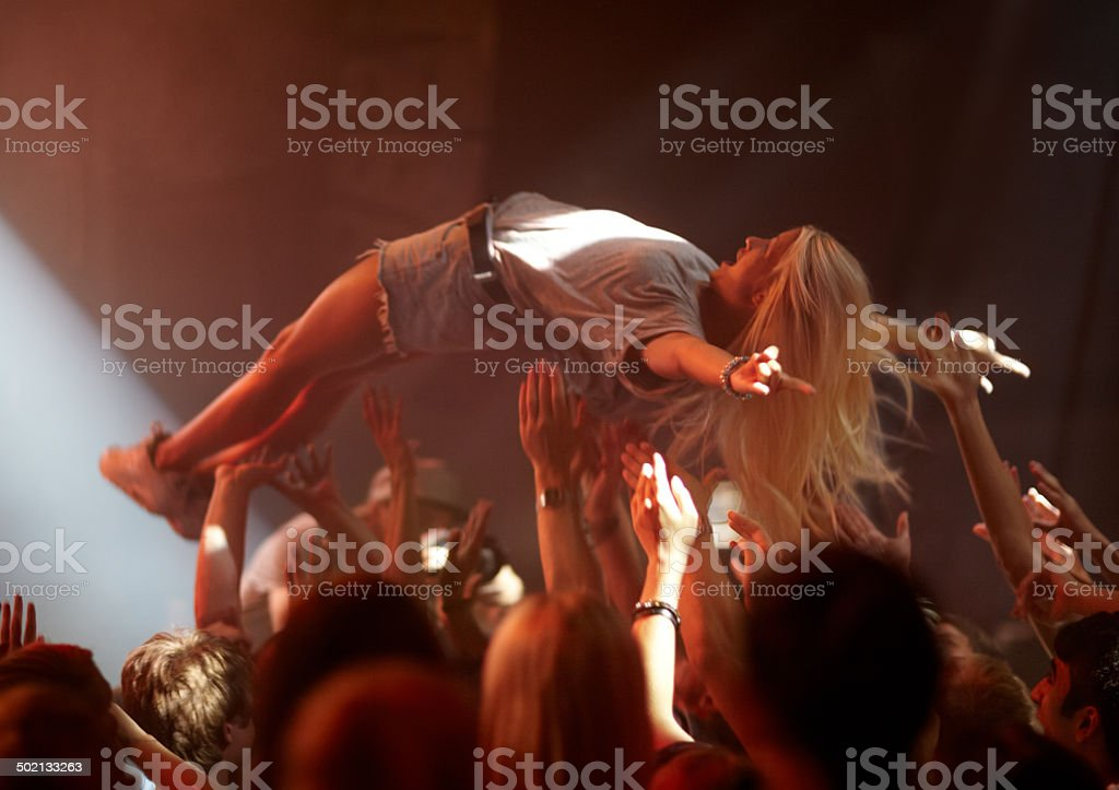 Surfing the crowd stock photo