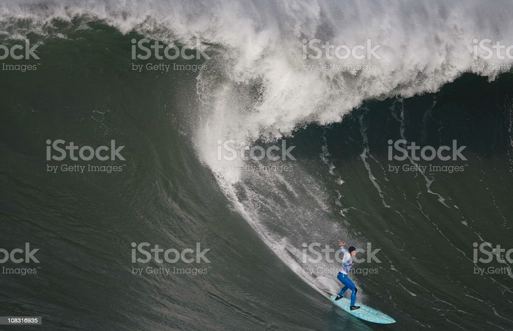 Surfing the curl of a huge wave stock photo