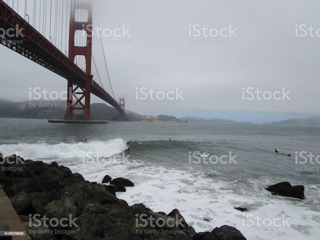 Surfing the Golden Gate Bridge stock photo