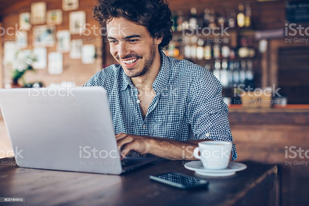 Surfing the net in the cafeteria stock photo