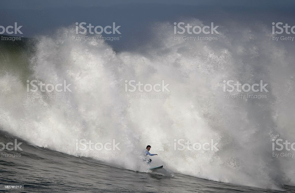 Surfing the Spray of a Huge Wave stock photo