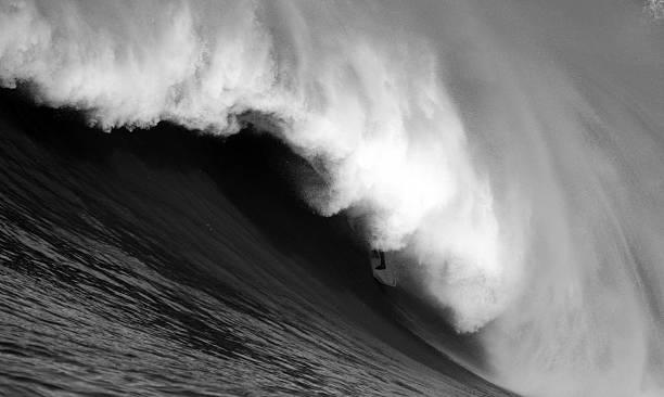 Surfing the Spray stock photo