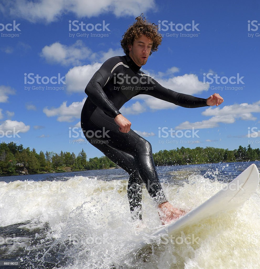 Surfing the Wake royalty-free stock photo