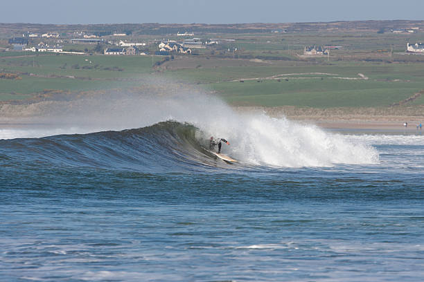 surfing the waves - county clare stock pictures, royalty-free photos & images